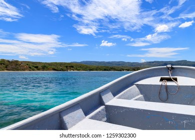 Fishing boat in the caribbean, turquoise sea on the coast. Dominican Republic