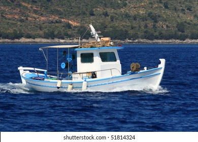 fishing boat and clear blue sea
