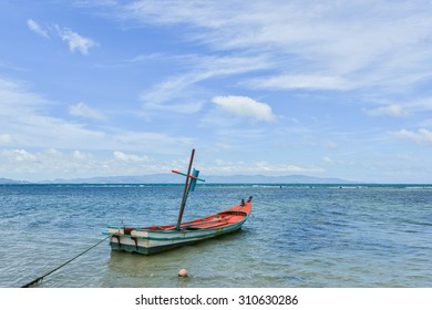 Fishing boat in clear blue sky with cloud and sea in shiny day.