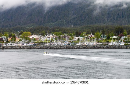 Fishing boat coming into Sitka, Alaska after a long day of fishing in the ocean.