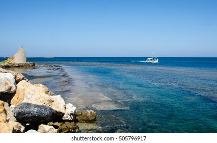 Fishing boat in deep blue sky and sea. Skyros island, Greece
