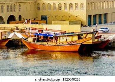 Fishing boat docked at port of souq al jubail