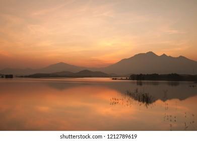A Fishing boat in Dong Mo Lake at Sunset