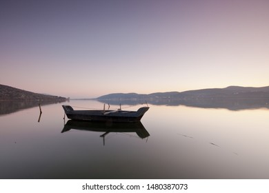 Fishing boat during sunset in the lake of Kastoria, Greece