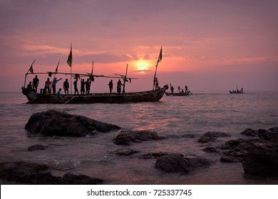 Fishing boat and fishermen at sunrise in Senya Beraku, Ghana