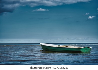 Fishing boat floating on the water, blue sea and sky with copy space