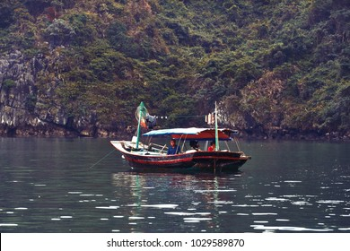 Fishing boat in Ha long Bay, Panoramic view of sunset in Halong Bay, Vietnam, Southeast Asia,UNESCO World Heritage Site