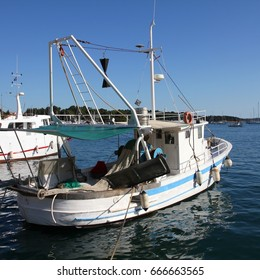 Fishing boat in the harbor of Porec, Croatia. Istria peninsula, Adriatic sea.