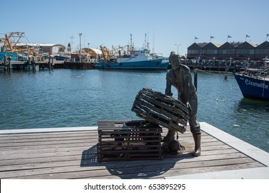Fishing Boat Harbour,crowds and statue in Fremantle,Western Australia/Harbour Sculpture/FREMANTLE,WA,AUSTRALIA-NOVEMBER 13,2016:Fishing boat harbour, crowds and statue in Fremantle,Western Australia