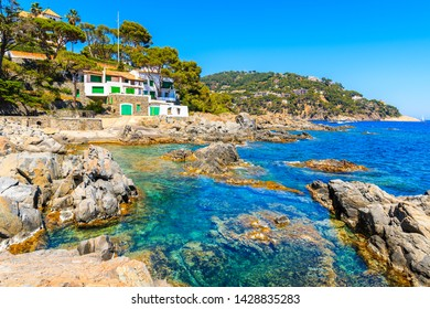 Fishing boat house on sea coast in Calella de Palafrugell fishing village, Costa Brava, Spain