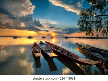 Fishing boat and houseboat evening clouds on sunset,Si sa ket,Thailand - Shutterstock ID 324445061