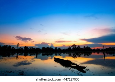 Fishing boat and houseboat evening clouds on sunset,Si sa ket,Thailand - Shutterstock ID 447127030