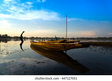 Fishing boat and houseboat evening clouds on sunset,Si sa ket,Thailand - Shutterstock ID 447127051