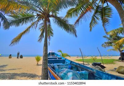 A fishing boat kept in marari sea beach in Kerala.