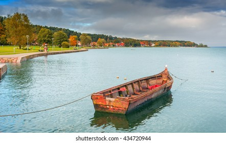 Fishing boat in lagoon of Curonian spit in autumn, Lithuania, Europe