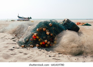 fishing boat and fishing net on the sea shore. tropical landscape.