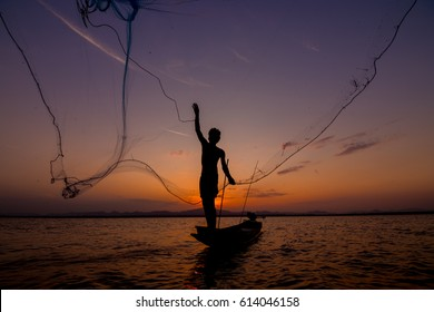 Fishing boat nets sow at sunset
