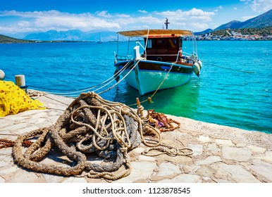Fishing Boat off the coast of Crete with marine rope and fishing net in the foreground. Elounda, Mirabello Bay, Crete, Greece