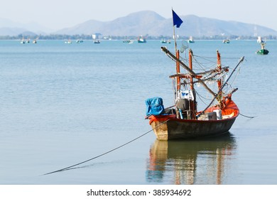 Fishing Boat off the coast with marine rope in prachuap khiri khan gulf of thailand.