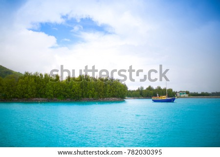 Fishing Boat Off The Coast Of The Tropical Island Landscape