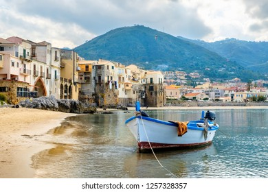 Fishing boat in old Harbour. Cefalu, Sicily, Italy