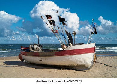 Fishing boat on the beach of the Baltic Sea at Rewal in Poland