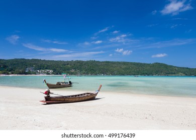 Fishing boat on the beach with clear blue sky background, south of Thailand