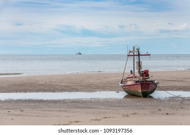 Fishing boat on the beach in the evening.