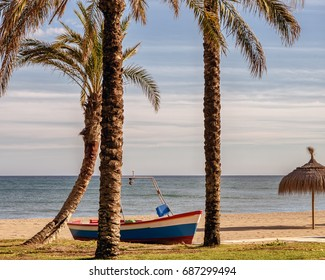 Fishing boat on the beach in Marbella, Costa del Sol, Spain.