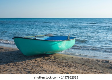 Fishing boat on the beach . Boat with oars