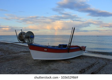 Fishing boat on the beach and rainbow