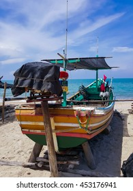 Fishing boat on the beach, Songkhla,Thailand.Blue sky.
