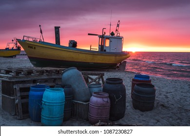 Fishing boat on the beach at sunset. Baltic sea.