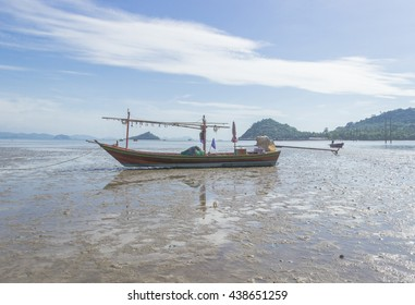 fishing boat on beach waiting for tide up