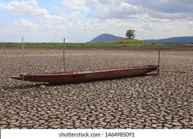 Fishing boat on drought conditions of reservoirs in Pa Sak Jolasid Dam Lopburi, Thailand. The drought crisis in many years ago.