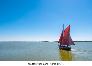 Fishing boat on a lake with blue sky.