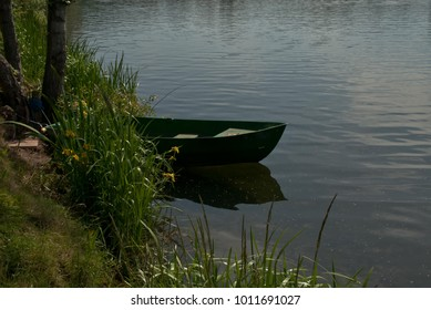 Fishing boat on the lake shore