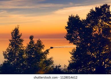 Fishing boat on Lake Superior at sunset