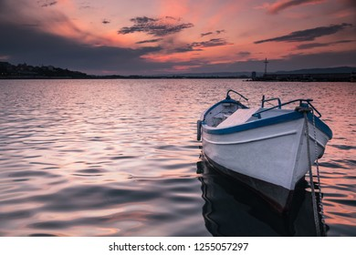 Fishing boat on the port at sunset
