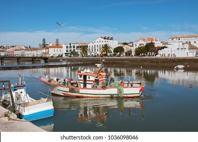 Fishing boat on the river Gilao in Tavira on a sunny day, Portugal