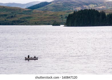 Fishing boat on a Scottish loch with highland landscape in the background