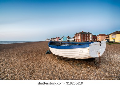 A fishing boat on the shingle beach at Aldeburgh on the Suffolk coast