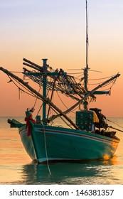 Fishing Boat on sunset  a background of  beautiful sunset