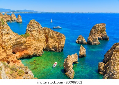 Fishing boat on turquoise sea water at Ponta da Piedade, Algarve region, Portugal