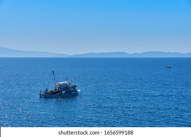 Fishing boat on the water catching fish