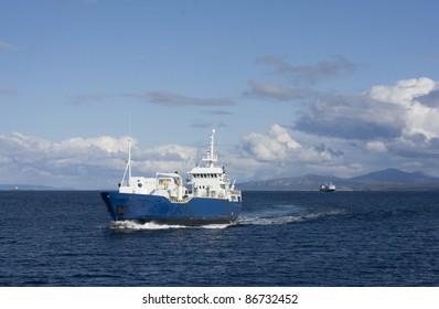 Fishing boat and passenger boat at the Norwegian coast