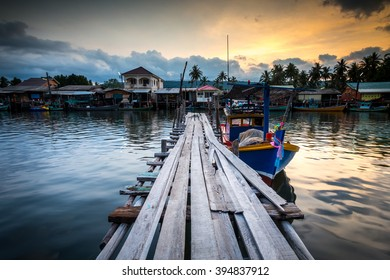 fishing boat at the pier in thai fishing village