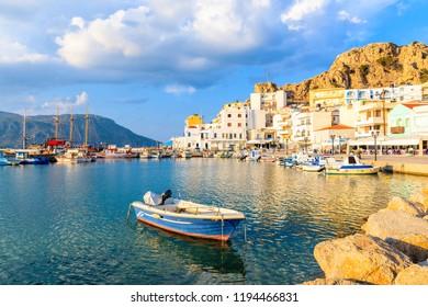 Fishing boat in Pigadia port at sunset time, Karpathos island, Greece