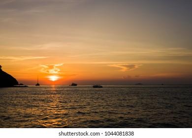 Fishing boat of the sea traveler Sunset.