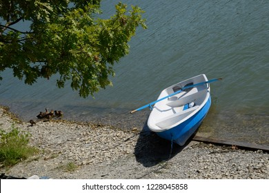 Fishing boat at the shore of the lake. Boat with oars
